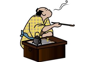 煙管で煙草を吸う